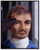 Man in white polo neck