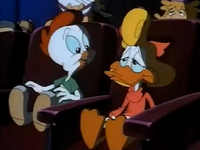 Shirley sitting next to Fowlmouth while he is flapping his beak.