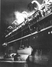 Atlantic Titanic Movie LifeBoats being Lowered away.jpg