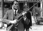 Atticus with gun