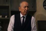 Kunio Murai como Kuzen Yoshimura