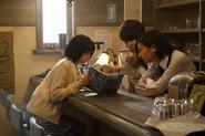 Touka, Kaneki, and Hinami reading together