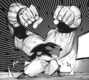 Saiko forms massive fists with her kagune