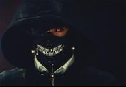 Kaneki wearing a hood and mask