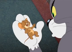 Tom and Jerry The Magic Ring - Jerry laughing in Tom's hand.PNG