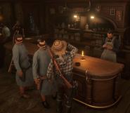 Arizona drinking next to the masked men