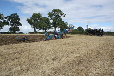 The plough with furrow press beung pulled up to the top engine