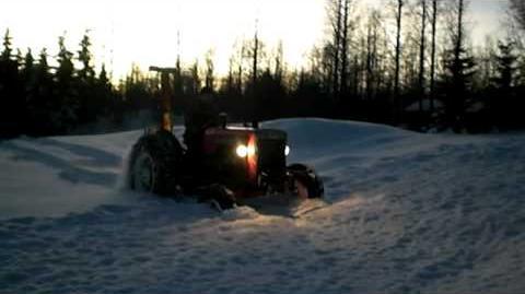 Valmet 361 and Rysky Log Winch in snow