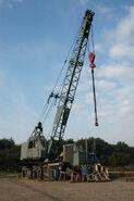 ALLEN-GROVE H2564 Cranetruck 6X4 Diesel working in a boatyard