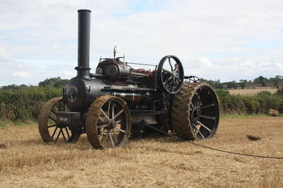 Fowler engine 15673 at the top of the field the bottom engine is pulling the plough and this one is lust letting the winch drum free wheel to pay the cable out.