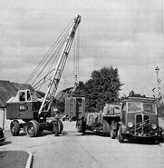 A 1950s NEAL Mobilecrane 10T loading an ERF