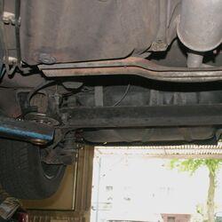 Twist-beam rear suspension