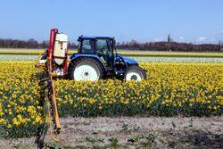 New Holland TL 90 and field sprayer 1.jpg
