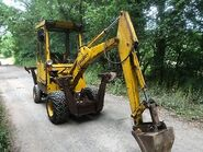 A 1990s Smalley-425 Mini-Digger-Excavator