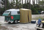 VW bus with attached small tent