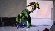 TrueColors Grimlock bashes Autobots