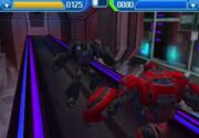 Rise of the Dark Spark 3DS Soundwave Battling Cliffjumper.jpg
