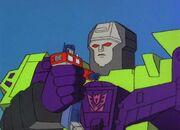City of Steel Optimus Prime in Devastator's Hand.jpg