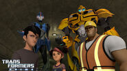 Jack, Miko, and Vogel with Arcee and Bumblebee