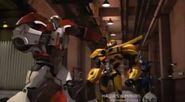 Ratchet intimidates Bumblebee
