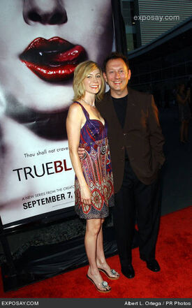 Carrie-preston-and-michael-emerson-hbo-series-true-blood-los-angeles-premiere-arrivals-NhKMLq.jpg