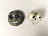 Thomas'grinningfaceandeyeplateTomsProps