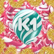 К1 (шестой логотип со сладостями)