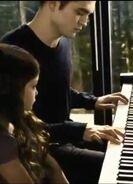 Edward-playing-Renesmee-s-lullaby-edward-and-bella-32785569-375-520