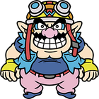 An overweight character with pointy ears, a pink nose, thick eyebrows, muscular arms and a wavy moustache. He wears a navy blue shirt with a light blue jacket, pink pants with a red belt, blue shoes, and yellow biker gloves with a blue W. On his head, a yellow biker helmet with a blue W, goggles, and a red strap.
