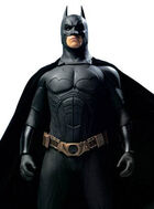 A man in a batsuit, with a cowl on his head, a utility belt, and a cape flowing behind him.