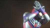 Tiga Blast covers his eyes when Kamila henshin