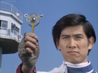 Kotaro holds the Ultra Badge for the last time