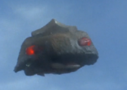 Black dome flying.png