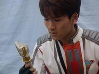 Daigo holding the spark lens