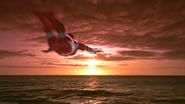 Zearth flying away