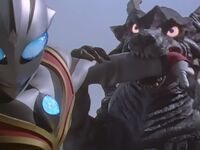 Gardi tries to stop Evil Tiga