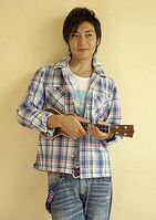 Takeshi with a guitar