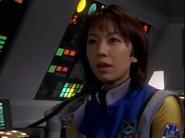 Atsuko looks at Agul