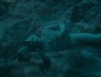 Tiga's statue in the sea