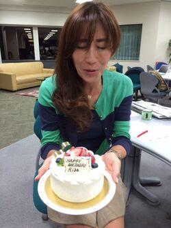 Risa with her birthday cake.jpg