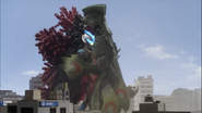 Ginga is caught in a combat hug between Velokron and Doragory