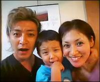 Takeshi with his wife and son