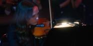 Vanya plays at her concert.