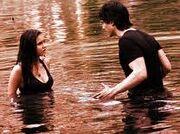 Damon pushing Elena into lake.jpg