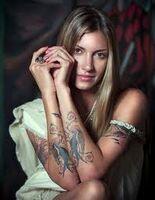 Dawn Olivieri-tattoo-has lots of them