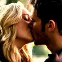 Caroline and Klaus kiss.,.