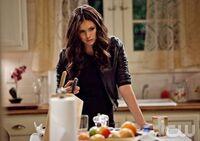 Elena conspiring in kitchen