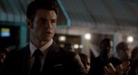 Elijah offering his hand to Hayley 1x22