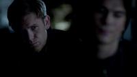 Alaric watches Damon