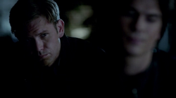 Alaric watches Damon.png